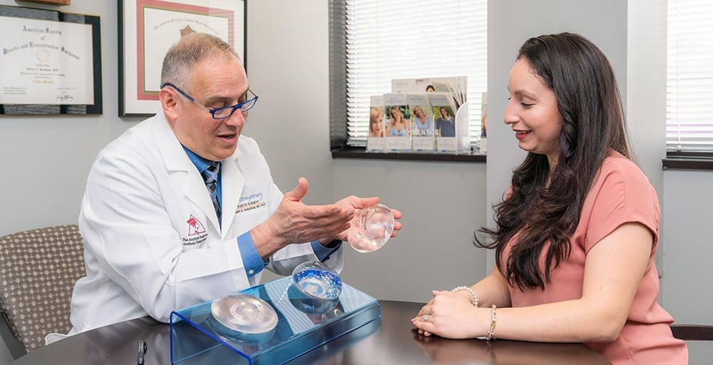 Dr. Herbstman Showing Female Patient Silicone Breast Implant