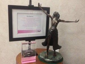 Statue Next to Frame and Glass Plaque