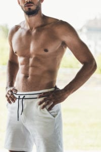 Male Torso With Six Pack Wearing White Shorts